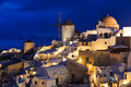 Dusk at oia santorini greece traditional windmills night in the town of Stock Image