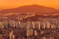Dusk over seoul settles the endless cityscape of south korea Stock Photo