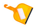 Dust pan brush a right angle view of a small orange with cleaning snapped into handle on white Stock Photography