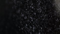 Dust particles falling on black background macro Royalty Free Stock Photos