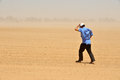 Dust and sand storm nirim isr june man fights a on june storms increase the spread of disease across the globe when ground virus Stock Photo