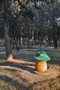 Dustbin a mushroom shape in park forest Royalty Free Stock Photography