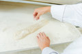 Dusting baguette with flour Royalty Free Stock Photo