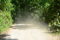 Dusty road to forest kangkrachan national park phetbury thailand Royalty Free Stock Image