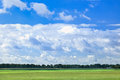 Dutch agrarian landscape with dramatic shaped clouds Royalty Free Stock Photo