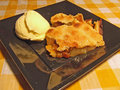 Dutch apple pie with ice cream a plate of vanilla Royalty Free Stock Photography