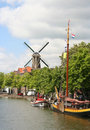 Dutch Canal and Windmill Stock Photography