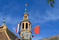 Dutch celebrations bell tower with orange and flags during the celebration of koningsdag king s day in the netherlands Stock Photo