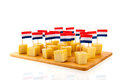 Dutch cheese cubes with flags isolated over white background Royalty Free Stock Image