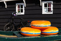 Dutch Cheese wheels on a green cart Royalty Free Stock Photo