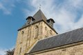 Dutch church with tower against a blue sky brick stone Royalty Free Stock Images