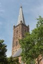 Dutch church tower against a blue sky old Royalty Free Stock Photos