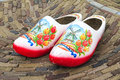 Dutch clogs typical wooden klompen painted with tulips and a windmill Royalty Free Stock Photo