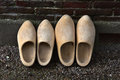 Dutch clogs wooden leaning against a wall Stock Image