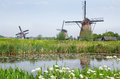 Dutch country landscape with windmills in spring Royalty Free Stock Photos