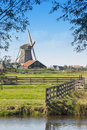 Dutch Countryside with Windmill Stock Images