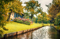 Dutch county side typical of houses and gardens Royalty Free Stock Photo