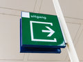 Dutch exit sign green indicating in and through symbol Stock Images