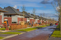 Dutch family houses in a suburban street Royalty Free Stock Photo