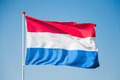 Dutch flag of the netherlands waving in the wind Stock Photography