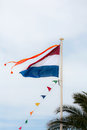 Dutch flag of red white and blue with orange pennant against blue sky Stock Image