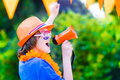 Dutch football fan happy little boy cheering and supporting soccer team of netherlands during championship celebrating sports Royalty Free Stock Photos
