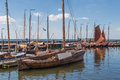 Dutch harbor of urk with traditional wooden fishing boats several Royalty Free Stock Photo