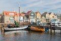 Dutch harbor of urk with wooden fishing ships traditional and houses Royalty Free Stock Photos