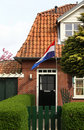 Dutch house with a national flag Royalty Free Stock Photos