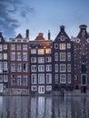 Dutch houses on the Damrak in Amsterdam.