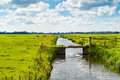 Dutch landscape with canal across fields Stock Image