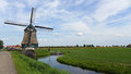 Dutch landscape a with a windmill Royalty Free Stock Photo