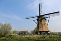 Dutch landscape with a windmill beautiful in Royalty Free Stock Image