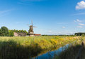 Dutch landscape with windmill Royalty Free Stock Photo