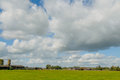 Dutch landscapes maurik gelderland view of polder landscape with farms and grassland against a blue cloudy sky background at the Stock Images