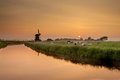 Dutch Polder Landscape during Orange Sunset Royalty Free Stock Photo