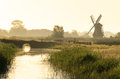 Dutch polder summer sunrise in a with a windmill Stock Photo