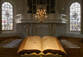 Dutch protestants church interior seen from the pulpit with open bible Royalty Free Stock Photos