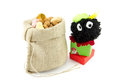 Dutch sinterklaas tradition called with zwarte piet presents and burlap sack filled with pepernoten Stock Photo