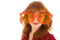 Dutch soccer fan young red haired woman as with funny glasses Royalty Free Stock Photo