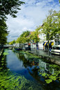 Dutch street with canal Royalty Free Stock Images