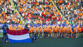 Dutch team the hague netherlands june is posing with the flag before the match the netherlands belgium during the hockey Royalty Free Stock Photos