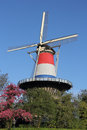 Dutch tower mill in leiden dressed in red white and blue this molen de valk was built has seven floors all open to the public it Stock Photography