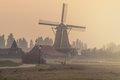Dutch windmill on a foggy afternoon Royalty Free Stock Photo