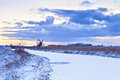 Dutch windmill frozen river winter sunrise Royalty Free Stock Images