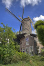 Dutch windmill historic windmil among the treesl in gouda holland Royalty Free Stock Photography