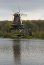 Dutch Windmill on Lake Stock Images