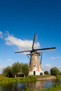 Dutch windmill at the river vlist in the netherlands Stock Images