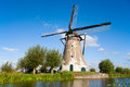 Dutch windmill at the river vlist in the netherlands Royalty Free Stock Photography
