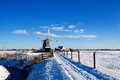 Dutch windmill in snow Royalty Free Stock Photo